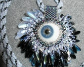 Eye Cry pendant made with real glass prosthetic eye