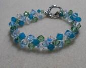 Beautiful Swarovski crystal bicone Mermaid bracelet in sea green and blue