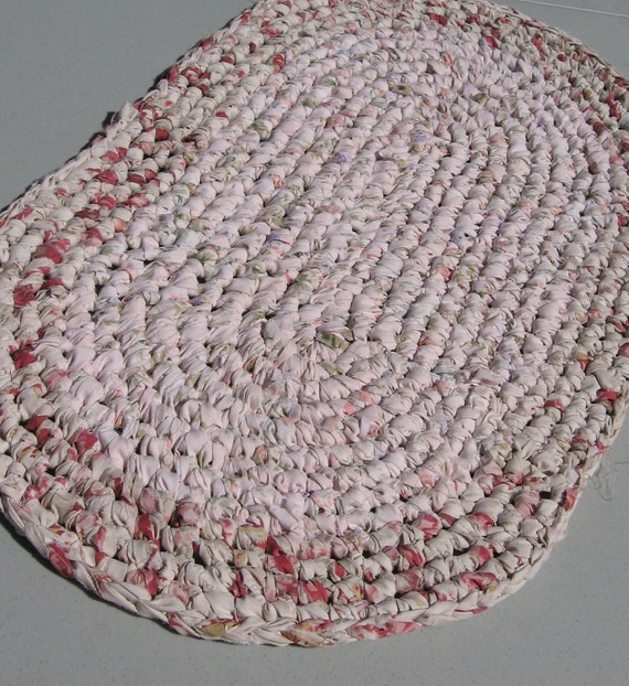 "crocheted rustic oval rag rug, table mat, pale pink, pastel flecks, 28"" long"
