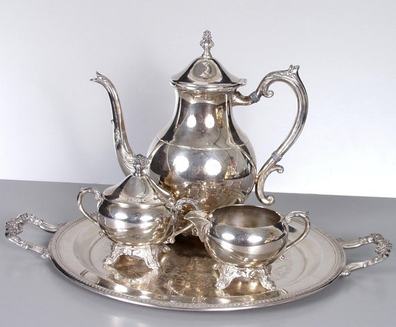 1883 FB Rogers Co. Tea Set - Four Piece Silver Plate with Pot, Creamer and Sugar on a Round Tray