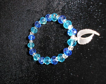 Shades of Blue/ Light blue and Dark blue faceted crystals w/angel wing charm