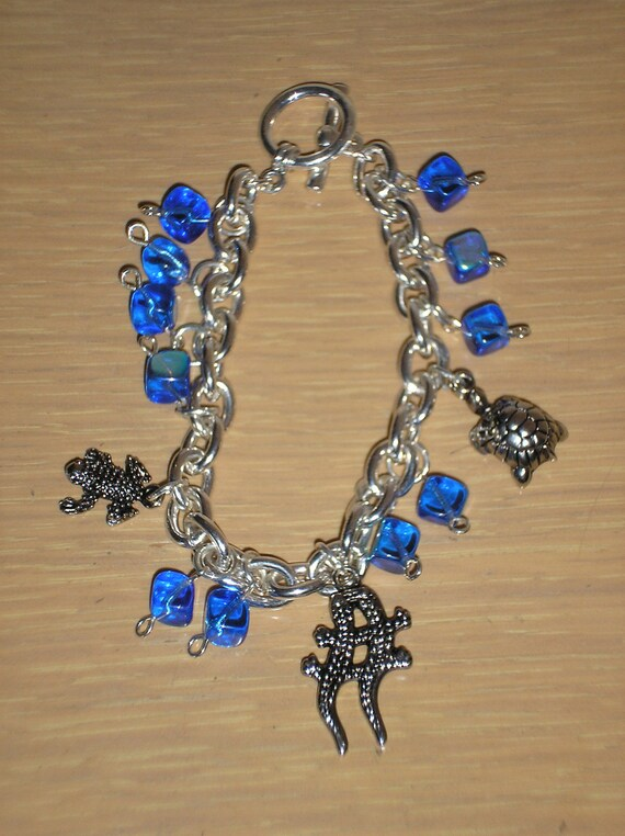 RESERVED FOR ROBIN/Amphibians in Motion/Charm bracelet with frog,turtle and lizards