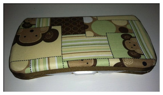 green and brown monkey travel wipe case