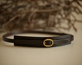 Skinny belt with solid brass buckle.