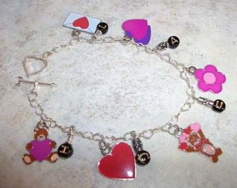 LAUGH enameled bear, hearts and flowers charm bracelet - PRICE REDUCED