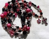 14 inch Black and Pink Glass Beaded necklace with charms