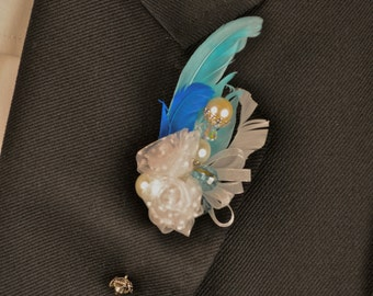 White and turquoise vintage inspired boutonniere