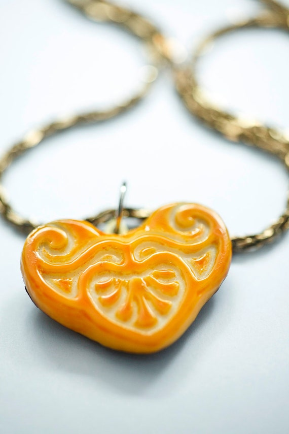 Orange and white Art Nouveau carving, carved out of tagua nut