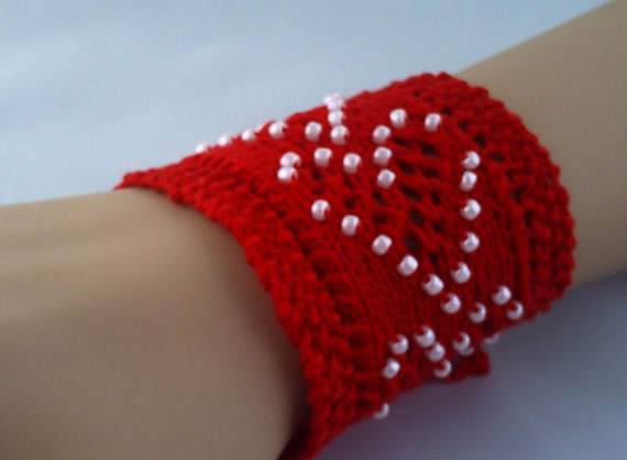 Red knitted wrist cuff with beaded hearts.On sale.