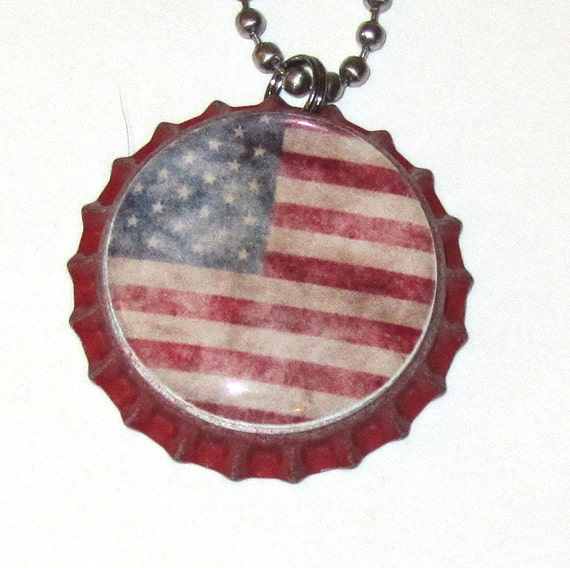 Flag deco bottle cap key chain or purse charm on distressed red