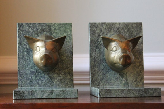 Brass and marble pig bookends