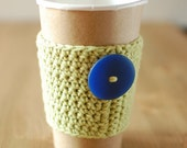Green coffee cozy  with blue button by The Cozy Project