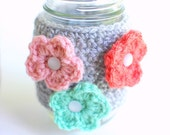 Mason Jar Cozy, Coffee Cup Cozy, Crochet Coffee Sleeve, Reusable Coffee Cozy with multi-colored flowers  by The Cozy Project