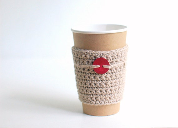 Natural cup cozy with red coconut button by The Cozy Project