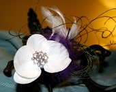 White Real Touch Exotic Orchid Flower Fixed with Rhinestone Center Purple and White Feathers along with Peacock Spray Feathers Fascinator