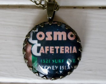 "Repurposed Vintage Advertising Art Pendant Necklace ""Cosmo Cafeteria"""