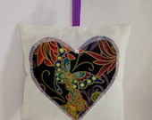 Small lavender pillow with abstract print heart