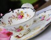 Antique CAULDON Footed Tea Cup Saucer Cobalt and Gilt , Floral, England c. 1905-20