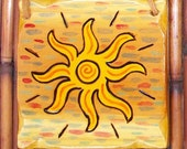 Wood burned sun with colorful sky