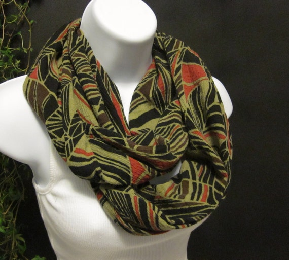 Cotton Gauze Infinity Double Loop Scarf in a Black, Orange, Brown and Khaki Tribal Leaf Print