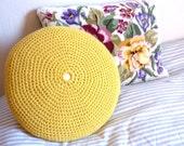 Yellow crochet cushion