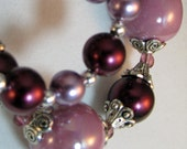 Purple, eggplant and violet glass pearl necklace with silver toned accents