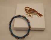 Indian Charm beaded Bracelet in electric blue swarovski and bronze