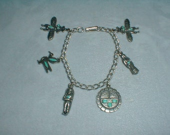 vintage antiqued silver tone faux turquoise native american themed charms bracelet
