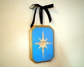 Holiday sheet music home decor.  Turquoise star wall hanging
