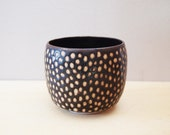 Black cup with dots