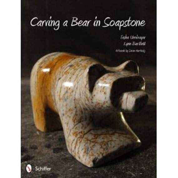Carving a bear in soapstone