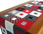 Quilted contemporary geometric table runner or wall hanging in red, black and white cotton