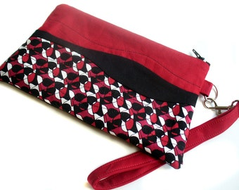 Quilted wristlet in black, white and red abstract geometric cotton with zipper closure