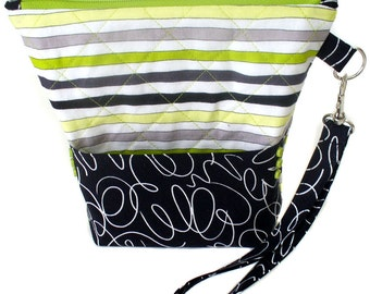 Quilted wristlet in lime green and black stripes cotton with zipper closure