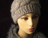 Chunky hand knit hat in a cable pattern.  Many colors available.  NEW YEAR SALE.