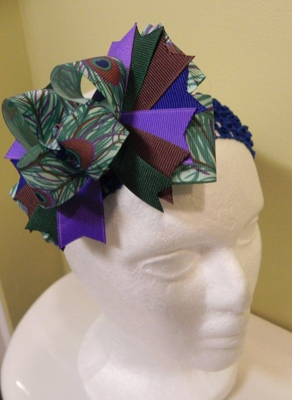 Large triple layer peacock bow