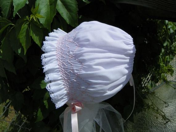 Newborn bonnet - white with pink smocking