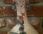 handmade copper swirls and feather pendant and earrings