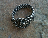 Silver and black twisted metals