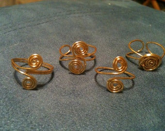 beautiful gold toe ring set of four