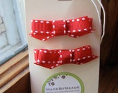 Two red grosgrain hair bows