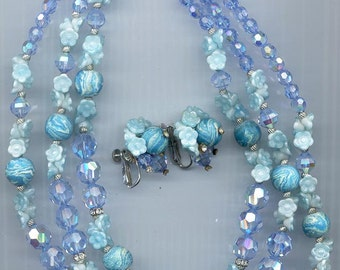 Fabulous 3-strand Vendome necklace and earrings -- light aqua glass flower clusters and light sapphire crystals.