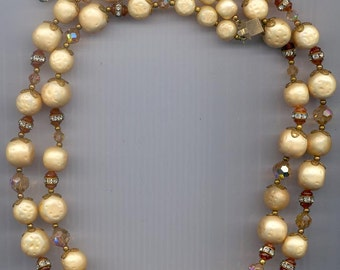 Lovely vintage 2-strand necklace with richly cream-colored lucite beads