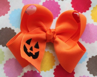 "Halloween Bow -- Pumpkin Bow -- Large Orange Boutique Bow embroidered with jack-o-lantern - Choose 4-5"" or 6-7"""