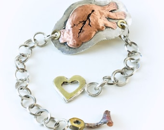 Anatomical Heart Bracelet with handmade silver chain and brass heart toggle clasp