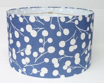 Drum lamp shade in a modern, fresh ink blue botanical print fabric by Thom Filicia