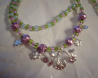 Handmade Pink Roses with Small Silver Flowers and a Silver Flower Bush  Background beads are pink, blue, green