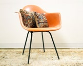 Early Peach Orange Herman Miller Chair