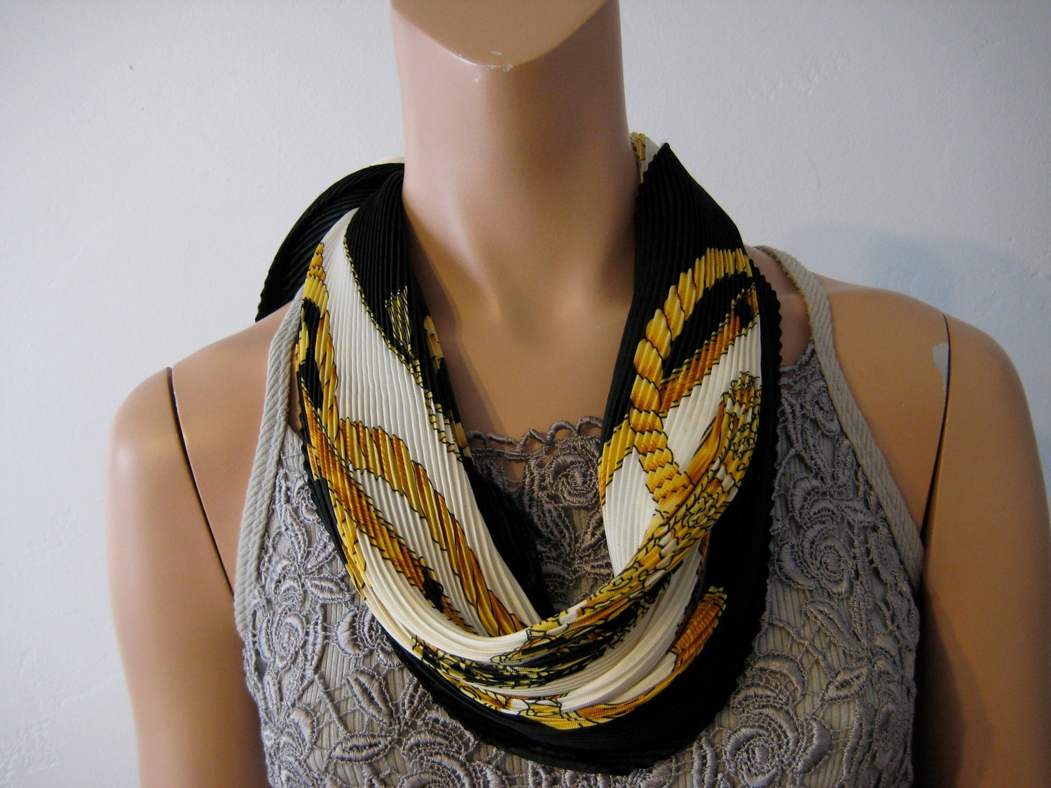 pleated scarf hermes style black gold and