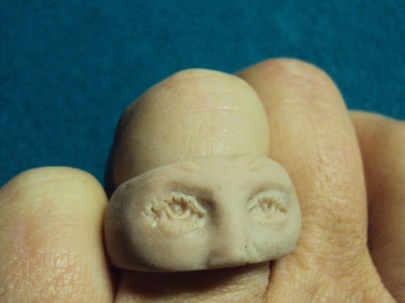 Faceless facein the nude porcelain cold clay eyes looking at you ring